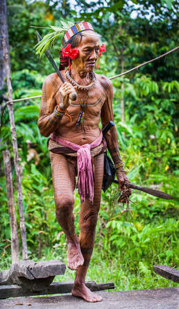 MENTAWAI PEOPLE, WEST SUMATRA, SIBERUT ISLAND, INDONESIA - 03 OKTOBER 2011: Man Mentawai tribe comes back home from hunting.