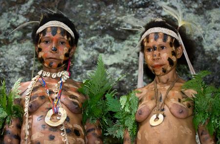 new guinea: NEW GUINEA, INDONESIA - 13 JANUARY: Women Yaffi tribe in traditional coloring. New Guinea Island, Indonesia. January 13th, 2009.