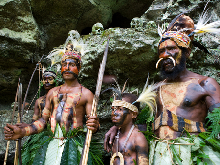 NEW GUINEA, INDONESIA - 13 JANUARY: Warriors tribe Yaffi in war paint with bows and arrows in the cave. New Guinea Island, Indonesia. January 13th, 2009. Editorial