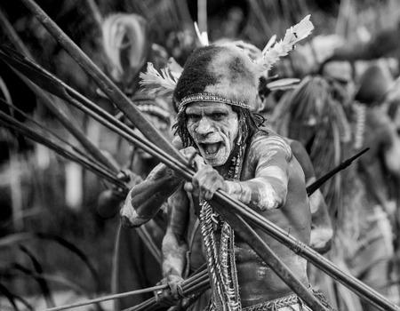 INDONESIA, IRIAN JAYA, ASMAT PROVINCE, JOW VILLAGE - JUNE 12: Asmat tribe warrior with bow and arrow.