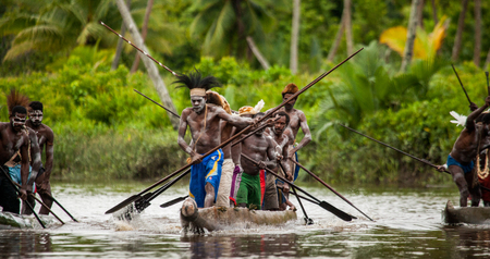 ancients: INDONESIA, IRIAN JAYA, ASMAT PROVINCE, JOW VILLAGE - JUNE 12: Warriors Asmat tribe are use traditional canoe.