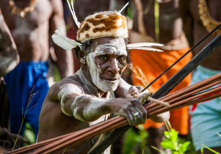 INDONESIA, IRIAN JAYA, ASMAT PROVINCE, JOW VILLAGE - JUNE 12: Asmat tribe warrior with bow and arrow.