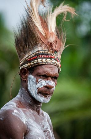 INDONESIA, IRIAN JAYA, ASMAT PROVINCE, JOW VILLAGE - JUNE 12: Portrait of a Warrior Asmat tribe in traditional headdress. Editorial