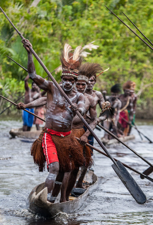 INDONESIA, IRIAN JAYA, ASMAT PROVINCE, JOW VILLAGE - JUNE 12: Warriors Asmat tribe are use traditional canoe.