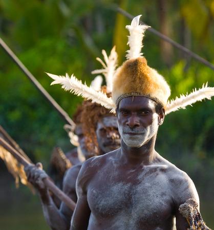 INDONESIA, IRIAN JAYA, ASMAT PROVINCE, JOW VILLAGE - JUNE 12: Portrait of a Warrior Asmat tribe in traditional headdress. Editoriali