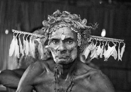 INDONESIA, IRIAN JAYA, ASMAT PROVINCE, JOW VILLAGE - JUNE 12: Portrait of a Warrior Asmat tribe in traditional headdress. Editorial