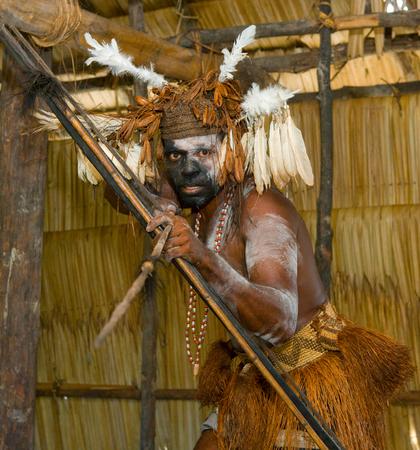 Nuova Guinea: INDONESIA, IRIAN JAYA, ASMAT PROVINCE, JOW VILLAGE - JUNE 12: Asmat tribe warrior with bow and arrow.