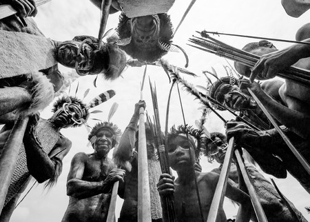 new guinea: DANI VILLAGE, WAMENA, IRIAN JAYA, NEW GUINEA, INDONESIA - 25 JULY 2009: Dani tribe Warriors.