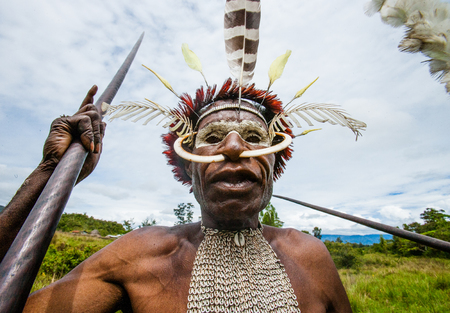 dani: DANI VILLAGE, WAMENA, IRIAN JAYA, NEW GUINEA, INDONESIA - 25 JULY 2009: Dani tribe Warriors.