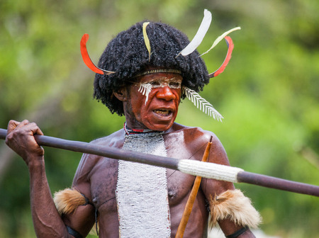 DANI VILLAGE, WAMENA, IRIAN JAYA, NEW GUINEA, INDONESIA - 25 JULY 2009: Dani tribe Warriors.