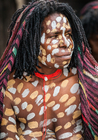dani: DANI VILLAGE, WAMENA, IRIAN JAYA, NEW GUINEA, INDONESIA - 15 MAY 2012: Portrait of Woman Dani tribe in ritual coloring on the body and face.