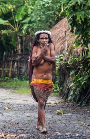 DANI VILLAGE, WAMENA, IRIAN JAYA, NEW GUINEA, INDONESIA - 15 MAY 2012: Woman Dani tribe in the traditional village.