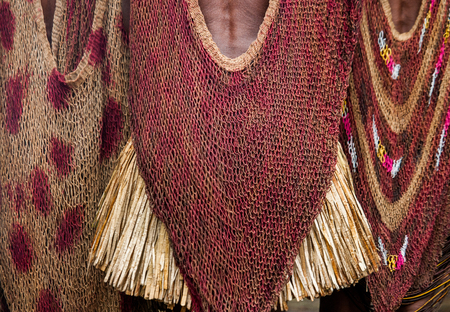 DANI VILLAGE, WAMENA, IRIAN JAYA, NEW GUINEA, INDONESIA - 15 MAY 2012: Detail of womens clothing Dani tribe.