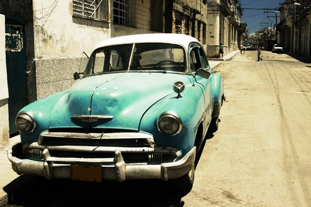 Street scene with vintage Chevy in central Havana. High contrast cross-processed look