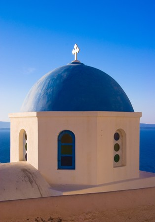 kyklades: The dome of a traditional greek church overlooking the sea in Oia, Santorini, Stock Photo