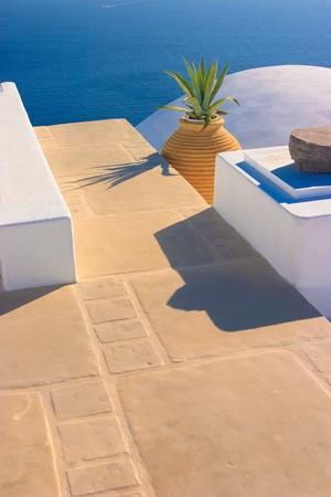 kyklades: Brilliant white architectural details against a bright blue sea  in Oia, Santorini, Greece