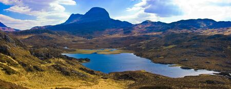 pictoresque: Mount Sulven with a small loch in the foreground in the Asynt region of the   western highland of Scotland