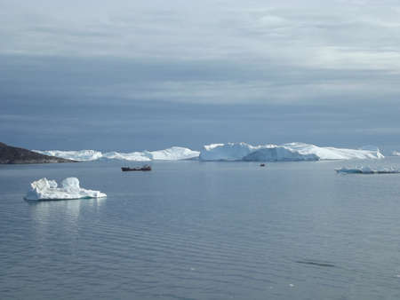 The mighty ice barrier near Ilulissat, Greenland, is formed from glacier ice of the Semeq Kujallek glacier floating through the kanga icefjord towards the open sea