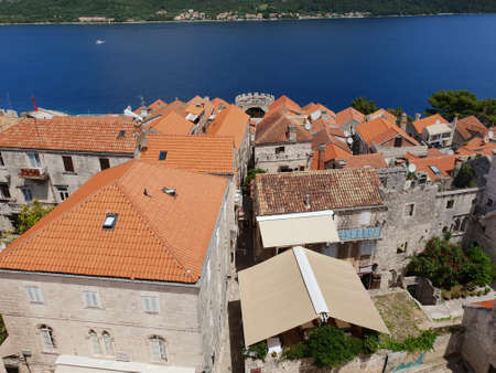 view from the bell tower of st. markus cathedral, korcula, croatia, upon the old town of korcula, the adriatic sea and coastal moutains