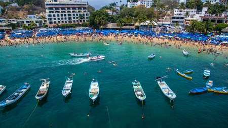 Speedboats from the sea, Caleta and Caletilla de Acapulco from a drone