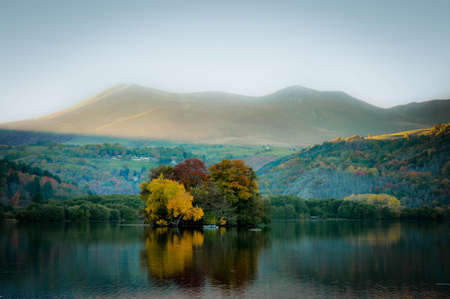 Reflections of Autumnal Colors on the Lake of Chambon