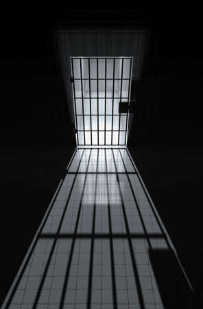 Prison cell with bars and sunbeam photo