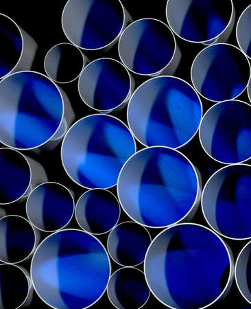 sewer: A stack of pipes in blue and black Stock Photo