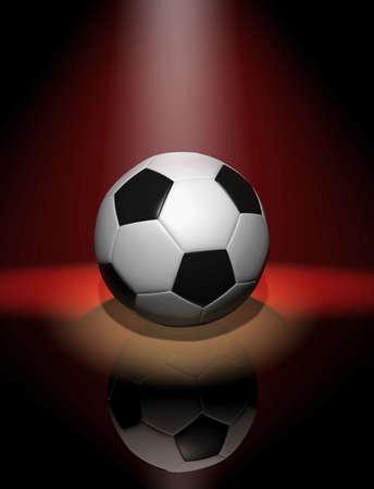 Soccer ball in red spotlight photo