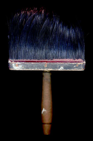 paperhanging: Wooden brush isolated on a black background