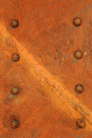 Rusty metal sheet with rivets photo