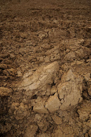 loamy: Ploughed farmland with brown loamy soil Stock Photo