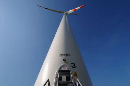 Modern wind turbine under a blue sky photo