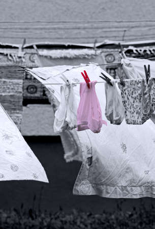 Laundry hanging on an outdoor clothesline photo