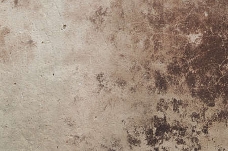 Eroded old plaster at a wall photo