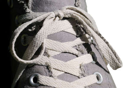 Close up of a grey linen shoe with white shoelace Stock Photo - 7701832