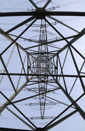 electrochemical: Electrical tower -  Inside view of a tall electrical tower under a clear sky Stock Photo