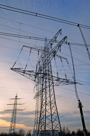 Electrical towers - Tall electrical towers under a clear sky Stock Photo - 8211910