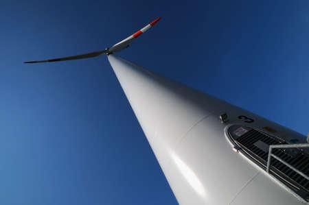 Wind turbine - Modern wind turbine under a blue sky photo