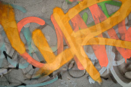 deface: Graffiti wall - Concrete wall with graffiti in different colours Stock Photo