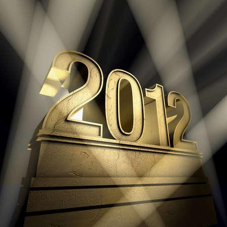 Year 2012   Number 2012 on a golden pedestal at a black background Banco de Imagens - 8611700