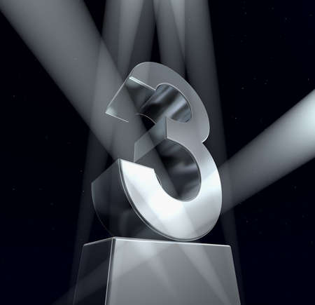 third: Number three Number three in silver letters on a silver pedestal
