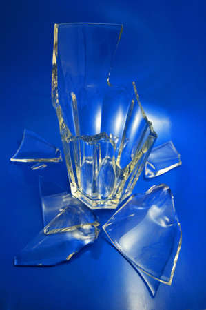 Broken glass Broken glass on a blue background photo