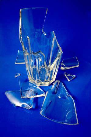 fragmentation: Broken glass Broken glass on a blue background Stock Photo