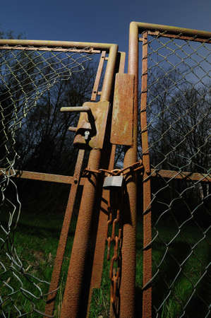 enclosures: Rusted garden gate Rusted garden gate with damaged wire-netting Stock Photo