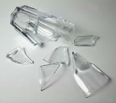 shard of glass: Broken glass Broken glass in white on a grey background Stock Photo