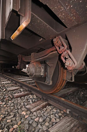 goods train: Train wheel and rails  Wheel of a goods train standing the on rails