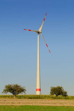 Wind turbine Modern wind turbine in white and red under a blue sky Stock Photo - 10965819