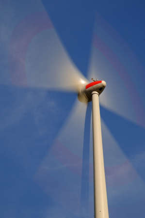 Wind turbine Rotating wind turbine under a blue sky photo