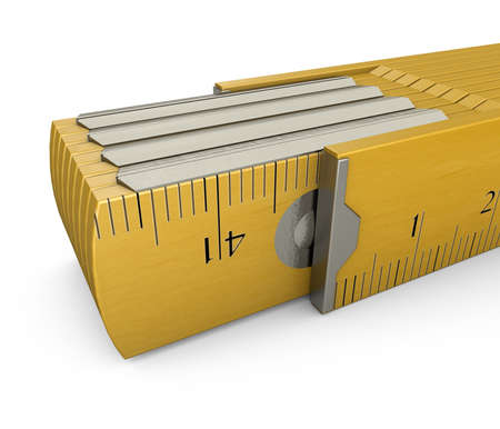 millimetre: Folding rule A folding rule in yellow at a white background Stock Photo