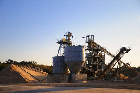 gravel pit: Gravel pit A gravel pit in the forest in sunshine  Stock Photo